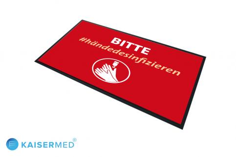 """LOGOMATTE CORONA mit der Aufschrift """"BITTE #händedesinfizieren"""" in rot - Bedruckter Teppich mit Symbol und Schrift"""