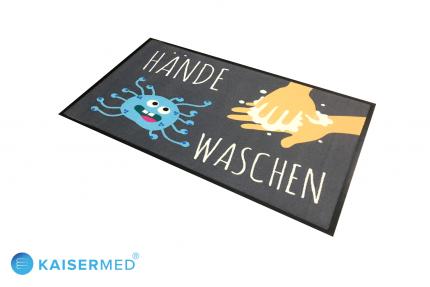 """EMCO bedruckte Logomatte mit der Aufschrift """"Hände Waschen"""" dazu ein Cartoon von einem Virus und Hände die sich waschen"""